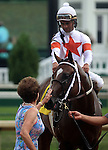 June 28, 2014:  Two year old colt Cinco Charlie (Indian Charlie x Ten Halos, by Marquetry) wins the G3 Bashford Manor Stakes at Churchill Downs with jockey Shaun Bridgmohan.  Owner Corinne Heiligbrodt gives him a pat before leading him into the winner's circle.  Trainer Steve Asmussen, owners Corinne and L. William Heiligbrodt. Breeder Candyland Farm.  ©Mary M. Meek/ESW/CSM