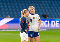 LE HAVRE, FRANCE - APRIL 13: Eugenie Le Sommer #9 of France talks with Lindsey Horan #9 of the USWNT after a game between France and USWNT at Stade Oceane on April 13, 2021 in Le Havre, France.