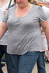 Ordinary fat young woman wearing grey top and blue jeans on holiday Wales. UK 2008.