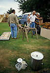 'ENGLISH VILLAGE FETE', DEREK EDWARDS AND OTHERS VILLAGERS HELP TO GET THE TRESALL TABLES READY FOR THE FETE.
