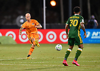 LAKE BUENA VISTA, FL - JULY 18: Aljaz Struna #5 of the Houston Dynamo passes the ball during a game between Houston Dynamo and Portland Timbers at ESPN Wide World of Sports on July 18, 2020 in Lake Buena Vista, Florida.