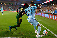 ST PAUL, MN - JULY 24: Juan Agudelo #21 of Minnesota United FC and Diego Chara #21 of the Portland Timbers for for the ball in the corner during a game between Portland Timbers and Minnesota United FC at Allianz Field on July 24, 2021 in St Paul, Minnesota.