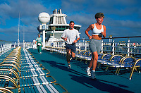 Man and woman running on deck of Royal Caribbean's Song of America cruise ship