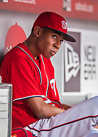 29 July 2017: Washington Nationals Manager's son Darren Baker sits in the dugout prior to a game against the Colorado Rockies at Nationals Park in Washington, DC. The Rockies defeated the Nationals 4-2 in the first game of their 3-game weekend series. Mandatory Credit: Ed Wolfstein Photo *** RAW (NEF) Image File Available ***