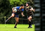 George Edwards of Howick beats the tackle of Morgan Timoti-Cook of Northcote. Fox Memorial Rugby League, Northcote Tigers v Howick Hornets, Birkenhead War Memorial Park Auckland, Saturday 22nd July 2017. Photo: Simon Watts / www.bwmedia.co.nz