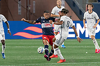 FOXBOROUGH, UNITED STATES - AUGUST 20: Jose Martinez #8 of Philadelphia Union tackles Gustavo Bou #7 of New England Revolution during a game between Philadelphia Union and New England Revolution at Gilette on August 20, 2020 in Foxborough, Massachusetts.