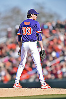 Clemson Tigers starting pitcher Zack Erwin (33) delivers a pitch during a game against the South Carolina Gamecocks at Fluor Field February 28, 2015 in Greenville, South Carolina. The Gamecocks defeated the Tigers 4-1. (Tony Farlow/Four Seam Images)