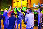 © Joel Goodman - 07973 332324 . 11/09/2016 . Manchester , UK . A group of men chant Manchester United songs on Withy Grove , despite the team's earlier loss against local rival Manchester City . Revellers out in Manchester City Centre . Photo credit : Joel Goodman