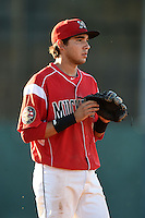 Batavia Muckdogs shortstop Hiram Martinez (15) during a game against the Mahoning Valley Scrappers on June 21, 2014 at Dwyer Stadium in Batavia, New York.  Batavia defeated Mahoning Valley 10-6.  (Mike Janes/Four Seam Images)