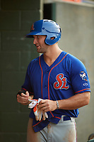 St. Lucie Mets left fielder Tim Tebow (15) in the dugout during a game against the Florida Fire Frogs on July 23, 2017 at Osceola County Stadium in Kissimmee, Florida.  St. Lucie defeated Florida 3-2.  (Mike Janes/Four Seam Images)