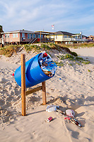 Full trash container on a beach of Bolivar Peninsula, Texas. Full, trash container, garbage, human debris, beach, Bolivar Peninsula, south, Texas, USA, united states