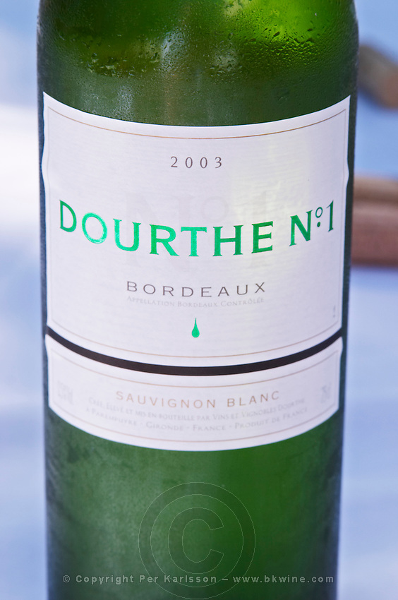 A cool bottle of white Bordeaux wine Dourthe N:o 1, 100% sauvignon blanc - Château Pey la Tour, previously Clos de la Tour or de Latour, Bordeaux, France
