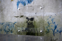 Pictured: The graffiti showing a rat holding a cigarette which has been painted on a wall in Llanelli, Wales, UK. Wednesday 20 February 2019 <br /> Re: A sheet of protective plastic has been placed over a graffiti as council officials in Llanelli, west Wales, determine if it could be a work by artist Banksy.<br /> Mayor David Darkin has sent images to the art dealer who bought Banksy's design Season's Greetings, painted on a garage in Port Talbot to verify its potential origin.