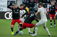 WASHINGTON, DC - FEBRUARY 29: Russell Canouse #4 of DC United and Ola Kamara #9 of DC United get the ball away from Nicolás Mezquida #20 of the Colorado Rapids during a game between Colorado Rapids and D.C. United at Audi Field on February 29, 2020 in Washington, DC.