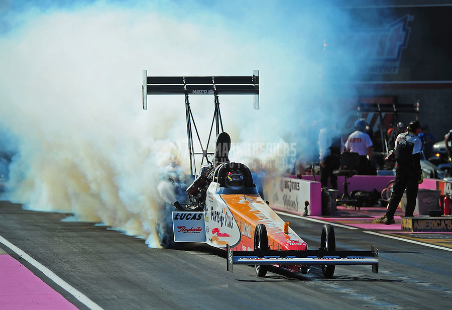 Oct. 30, 2011; Las Vegas, NV, USA: NHRA top fuel dragster driver Clay Millican during the Big O Tires Nationals at The Strip at Las Vegas Motor Speedway. Mandatory Credit: Mark J. Rebilas-
