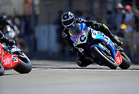 Richard Cooper (UK) chases Mitch Rees (left) in Formula One race two. 2019 Suzuki series Cemetery Circuit motorcycle racing at Cooks Gardens in Wanganui, New Zealand on Thursday, 26 December 2019. Photo: Dave Lintott / lintottphoto.co.nz