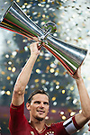 GUANGZHOU, GUANGDONG - JULY 26:  Daniel Van Buyten of Bayern Munich holds the trophy after winning a friendly match against VfL Wolfsburg as part of the Audi Football Summit 2012 on July 26, 2012 at the Guangdong Olympic Sports Center in Guangzhou, China. Photo by Victor Fraile / The Power of Sport Images