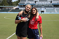 CARY, NC - SEPTEMBER 12: Lindsey Horan #10 of the Portland Thorns FC and Cari Roccaro #21 of the North Carolina Courage pose for a photo before a game between Portland Thorns FC and North Carolina Courage at Sahlen's Stadium at WakeMed Soccer Park on September 12, 2021 in Cary, North Carolina.