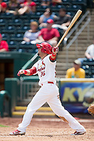 Luis Mateo #26 of the Springfield Cardinals follows through his swing during a game against the Tulsa Drillers at Hammons Field on May 7, 2013 in Springfield, Missouri. (David Welker/Four Seam Images)