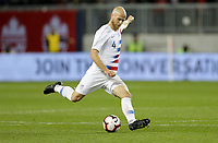 TORONTO, ON - OCTOBER 15: Michael Bradley #4 of the United States sends a ball downfield during a game between Canada and USMNT at BMO Field on October 15, 2019 in Toronto, Canada.