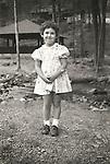Kirsten Wild in dress, age 4. Forkesville, PA. File #73-139-12a.