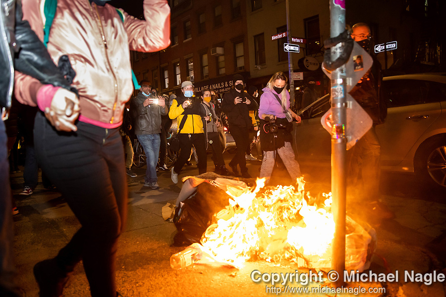 Demonstrators march past a fire during a protest demanding every vote cast be counted in the 2020 presidential election between U.S. President Donald Trump and former Vice President Joe Biden on November 4, 2020 in New York City.  Photograph by Michael Nagle