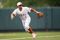 Texas Longhorns shortstop CJ Hinojosa #9 on defense during the NCAA baseball game against the Oklahoma State Cowboys on April 26, 2014 at UFCU Disch–Falk Field in Austin, Texas. The Cowboys defeated the Longhorns 2-1. (Andrew Woolley/Four Seam Images)