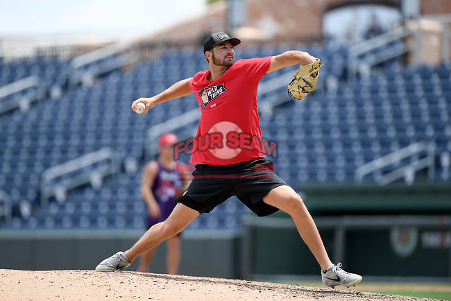 """Atlanta Braves pitcher Chad Sobotka, drafted out of USC Upstate, pitches in a """"Sandlot""""-style game to other pro and amateur players from the region on Thursday, June 25, 2020, at Fluor Field at the West End in Greenville, South Carolina, as team workouts remain shut down. (Tom Priddy/Four Seam Images)"""
