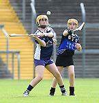 Rachel Guerin of Bridgetown in action against Emma Geary of Kilkee/Kilbaha during their Schools Division 6 final at Cusack Park. Photograph by John Kelly