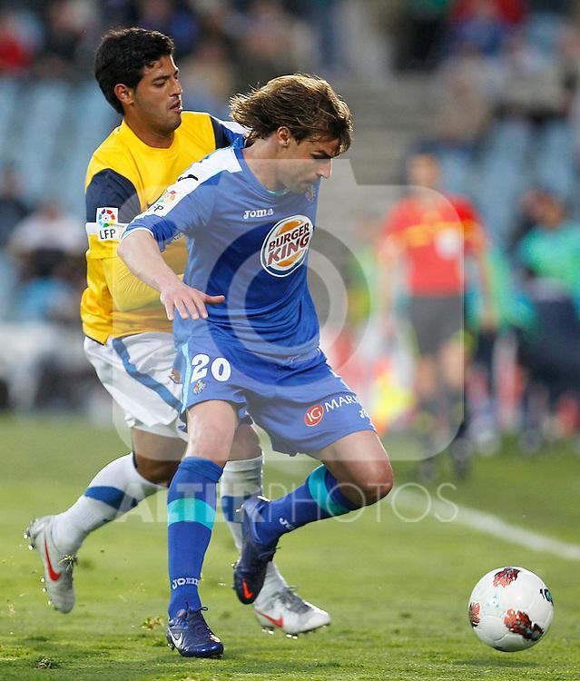 Getafe's Juan Valera (r) and Real Sociedad's Carlos Vela during La Liga match.March 17,2012. (ALTERPHOTOS/Acero)