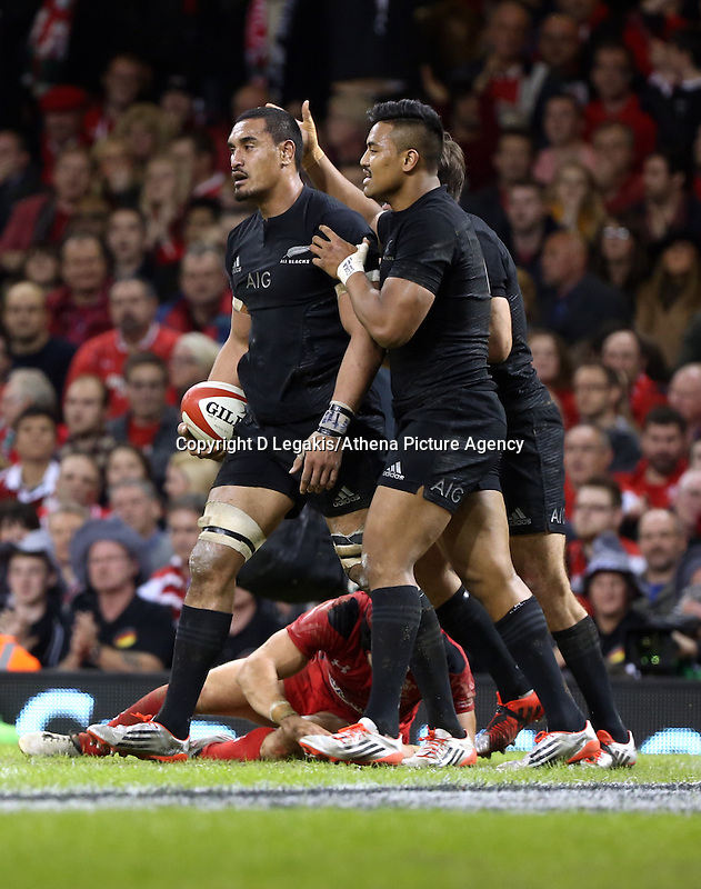Pictured: Keven Mealamu of New Zealand (R) celebrating after scoring a try Saturday 22 November 2014<br /> Re: Dove Men Series 2014 rugby, Wales v New Zealand at the Millennium Stadium, Cardiff, south Wales, UK.