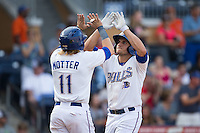 Mikie Mahtook (7) of the Durham Bulls high fives teammate Taylor Motter (11) after hitting a home run against the Louisville Bats at Durham Bulls Athletic Park on August 9, 2015 in Durham, North Carolina.  The Bulls defeated the Bats 9-0.  (Brian Westerholt/Four Seam Images)