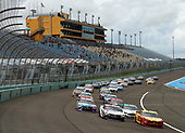 HOMESTEAD, FLORIDA - JUNE 14: Joey Logano, driver of the #22 Shell Pennzoil Ford, and Denny Hamlin, driver of the #11 Toyota, lead the field to start the NASCAR Cup Series Dixie Vodka 400 at Homestead-Miami Speedway on June 14, 2020 in Homestead, Florida. (Photo by Michael Reaves/Getty Images)