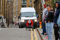 3rd October 2021; London, England: The Virgin Money 2021 London Marathon: Wheelchair competitor taking a short break while crossing Narrow Street Swing Bridge, Limehouse Basin between mile 14 and 15.