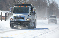 A city of Springdale snow plow continues to clear snow and ice on So. 40th Street in Springdale. Temperatures dipped to 20 degrees below zero in some parts of the region over night Monday and the National Weather Service forecast includes a slight chance of snow continue through the day Wednesday. Check out nwaonline.com/210217Daily/ and nwadg.com/photos for a photo gallery.<br /> (NWA Democrat-Gazette/David Gottschalk)