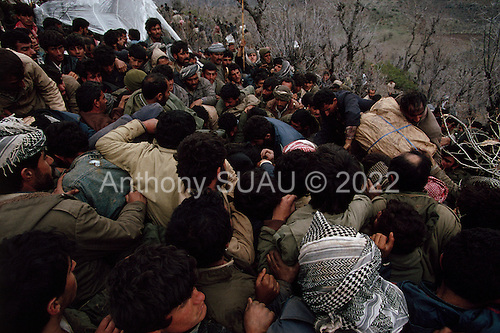 Isikveren, Turkey.April 12, 1991..A frenzied fight for food as large relief air-dropped food packages are opened in a Kurdish refugees camp. The camp housed an estimated 300,000 refugees that fled Saddam Hussein's post Gulf war persecution...In the wake of the 1991 Persian Gulf War rebellions in Southern and Northern Iraq occurred. The uprising in the Kurdish areas of Northern Iraq broke out in March, sparked by demoralized Iraqi Army troops returning from it's defeat against United States lead coalition forces in southern Iraq and Kuwait. Although they presented a threat to Iraqi President Saddam Hussein?s regime, his Iraqi Republican Guard suppressed the rebellion with massive force, as the expected US intervention never materialized. ..The faltering rebellion fueled a terrified mass exodus. The U.N. High Commissioner for Refugees called it the largest in its 40?year history. During March and early April, nearly two million of Iraqis escaped from strife-torn cities to the mountains along the northern borders and into Turkey and Iran. Their exodus was sudden and chaotic, with thousands fleeing on foot, on donkeys, or crammed onto open-backed trucks and tractors. Thousands, many of them children, died or suffered injury along the way, primarily from adverse weather, unhygienic conditions and insufficient food and medical care. Some were killed by army helicopters, which deliberately strafed columns of fleeing civilians. Others were injured when they stepped on land mines planted by Iraqi troops near the Iran border during the war. Greenpeace has estimated that at one point in 1991, an estimated 2,000 Kurds were dying every day..