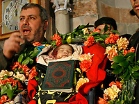 """Senior leeder of Islamice Jihad Khaled Albatush carries the body of a newborn Palestinian baby, whom Palestinian medics sThe body of one-month-old Palestinian baby girl Amira Abu Akar, lies in her house during her funeral in Gaza City, on March 5, 2008. The baby and a senior Islamic Jihad militant were killed during an Israeli brief military incursion into Gaza today, overshadowing a new peace push by US Secretary of State Condoleezza Rice.""""photo by Fady Adwan""""aid was killed by the Israeli forces gunfire late on Tuesday, in the central Gaza Strip March 5, 2008. Medical workers said the baby was killed and eight other people wounded by gunfire in the clash. The Israeli army said the military operation in central Gaza Strip was targeted at Palestinian militants.""""photo by Fday Adwan"""""""