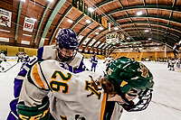 16 February 2019: University of Vermont Catamount Forward Ève-Audrey Picard, a Junior from Longueuil, Québec, is checked by Holy Cross Crusader Defender Victoria Young, a Junior from Hanson, MA, during a game at Gutterson Fieldhouse in Burlington, Vermont. The Lady Cats defeated the Crusaders 4-1 to sweep their 2-game weekend series. Mandatory Credit: Ed Wolfstein Photo *** RAW (NEF) Image File Available ***