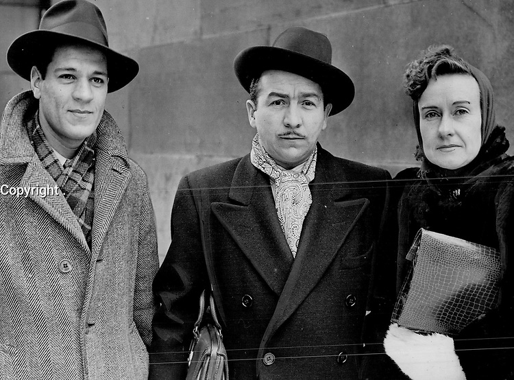 Fighting back against Quebec; Jehovah Witnesses are claiming $15;000 damages from the city of Montreal; their lawyer; A. L. Stein; centre discloses. A. Gaskin; left; and R. Guillette face trial in February<br /> <br /> PHOTO :    - Toronto Star Archives - AQP