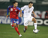Jonathan Bornstein #12 of the USA gets the better of Walter Centeno #10 of Costa Rica during a 2010 World Cup qualifying match in the CONCACAF region at RFK Stadium on October 14 2009, in Washington D.C.The match ended in a 2-2 tie.