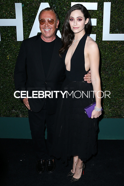 BEVERLY HILLS, CA, USA - OCTOBER 02: Michael Kors, Emmy Rossum arrives at Michael Kors Launch Of Claiborne Swanson Franks's 'Young Hollywood' Book held at a Private Residence on October 2, 2014 in Beverly Hills, California, United States. (Photo by Xavier Collin/Celebrity Monitor)