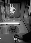 Penny Arcade Score a Bulls Eye with a ball down a hole and see a naked woman on the screen. Reno, Nevada, USA. 1969.