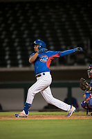 AZL Cubs 2 shortstop Henrry Pedra (12) follows through on his swing during an Arizona League game against the AZL Rangers at Sloan Park on July 7, 2018 in Mesa, Arizona. AZL Rangers defeated AZL Cubs 2 11-2. (Zachary Lucy/Four Seam Images)