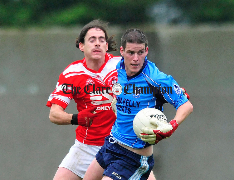 Kildysart's John Clancy gathers posession ahead of Martin Liddane of St Eoin's. Photograph by Declan Monaghan