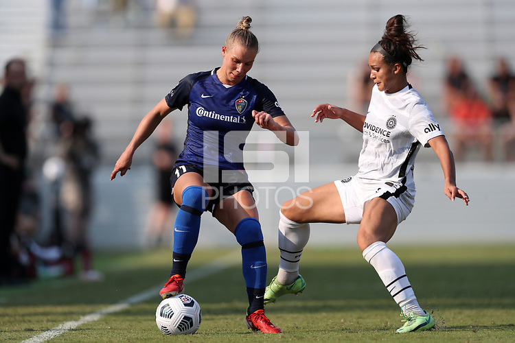 CARY, NC - SEPTEMBER 12: Sophia Smith #9 of the Portland Thorns FC challenges Merritt Mathias #11 of the North Carolina Courage for the ball during a game between Portland Thorns FC and North Carolina Courage at Sahlen's Stadium at WakeMed Soccer Park on September 12, 2021 in Cary, North Carolina.