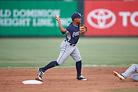 Shortstop Bryan Torres (12), of the AZL Padres 1, throws to first base to complete a double play during an Arizona League game against the AZL Angels on August 5, 2019 at Tempe Diablo Stadium in Tempe, Arizona. AZL Padres 1 defeated the AZL Angels 5-0. (Zachary Lucy/Four Seam Images)