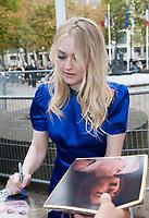 October 3 2017, PARIS FRANCE the Miu Miu<br /> Show at the Paris Fashion Week Spring Summer 2017/2018. Actress Dakota Fanning<br /> signs autographs.