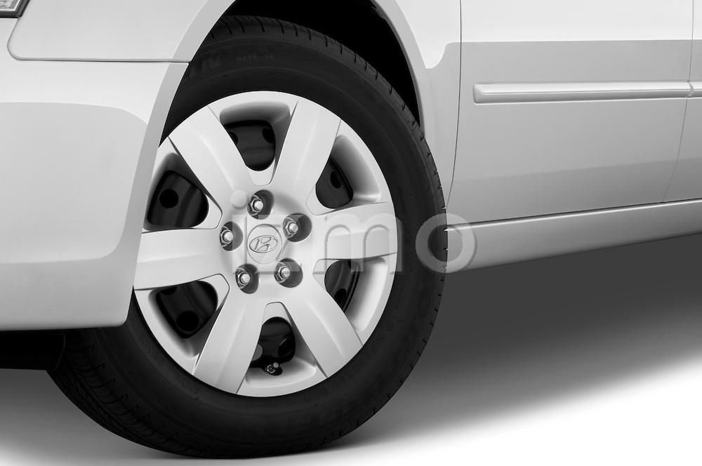 Tire and wheel close up detail view of a 2010 Hyundai Sonata GLS