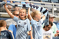 KANSAS CITY, KS - JUNE 26: Young Sporting KC fans wave a scarf during a game between Los Angeles FC and Sporting Kansas City at Children's Mercy Park on June 26, 2021 in Kansas City, Kansas.