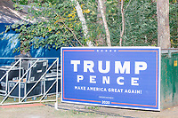 A Trump/Pence campaign sign stands against a dumpster near the stage as Donald Trump, Jr., son of president Donald Trump and a rising Republican political star, speaks at an outdoor campaign rally at The Lobster Trap in North Conway, New Hampshire, on Thu., Sept. 24, 2020.